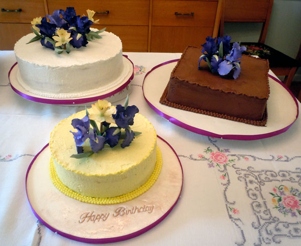 Realistic Looking Irises And Daffodils Finsih These Birthday Cakes Hand Painted Are