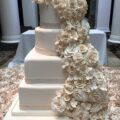 white rose fountain tiered bridal cake
