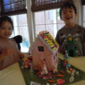The house is made from Gingerbread and is covered with fondant and candies.