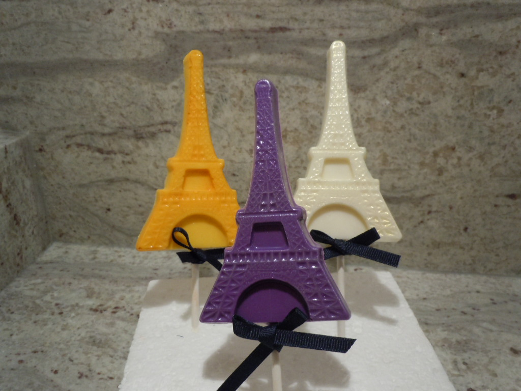 Eiffel Tower shaped chocolates on a stick.