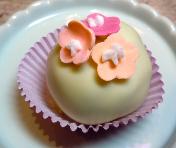 Elegant cake truffles topped with tiny flowers are a lovely finish to a bridal luncheon or shower.