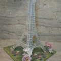 Edible Eiffel Tower made from sugar adorned with gumpaste flowers.