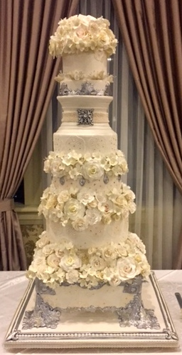 This spectacular wedding cake is supported by a Baroque inspired footed base all made with sugar mediums.