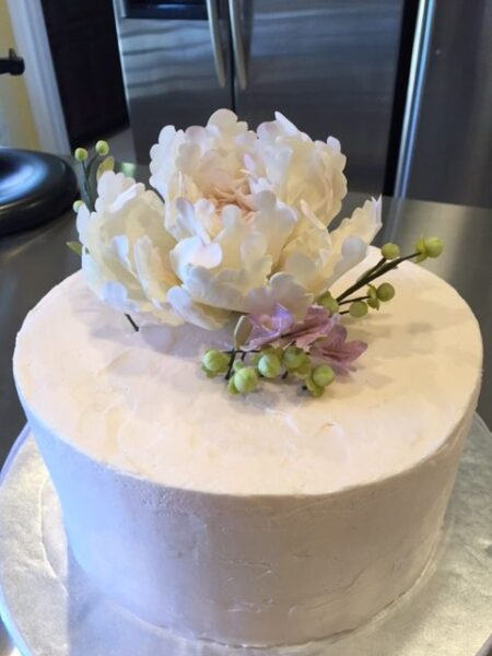 Edible peony cake topper complete with blossoms
