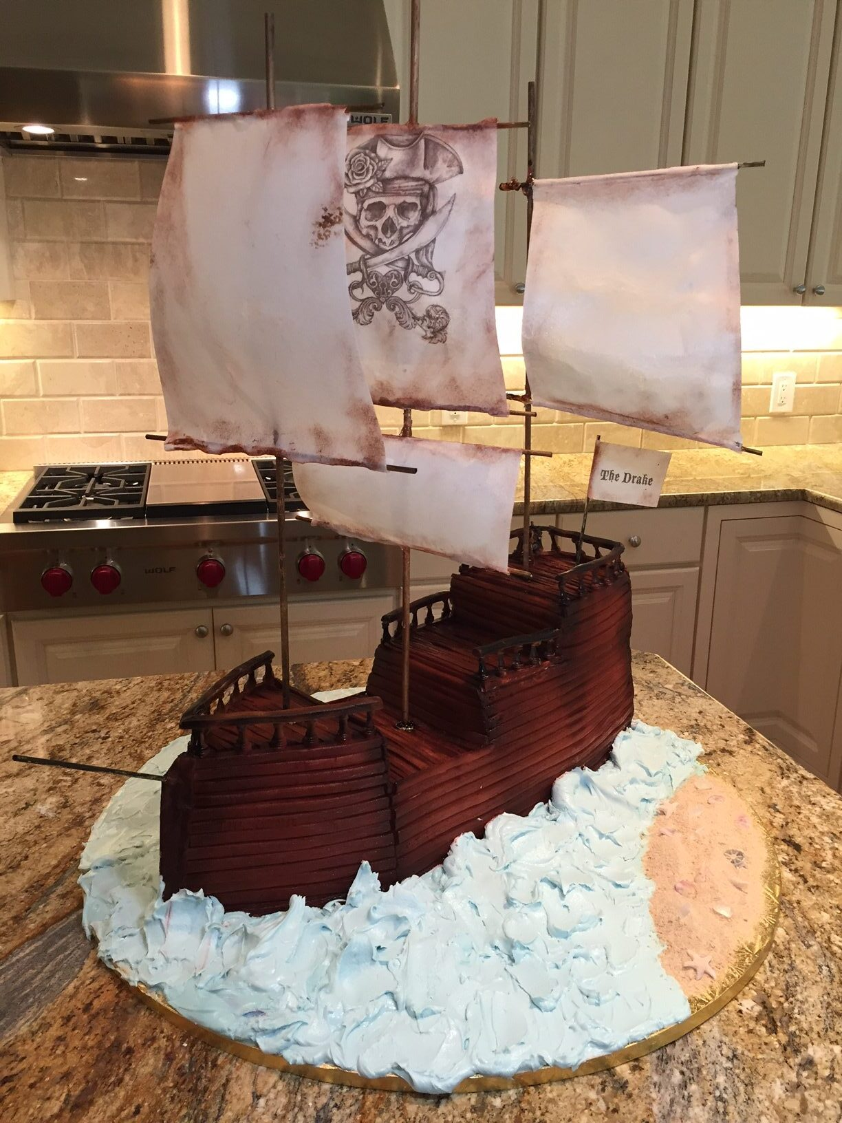 Pirate ship cake with edible wood planks and edible sails