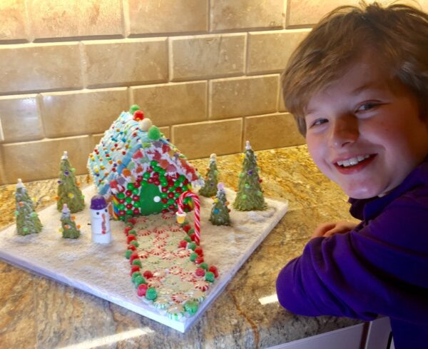 Young children enjoy building and decorating gingerbread houses throughout the year not just at Christmas time