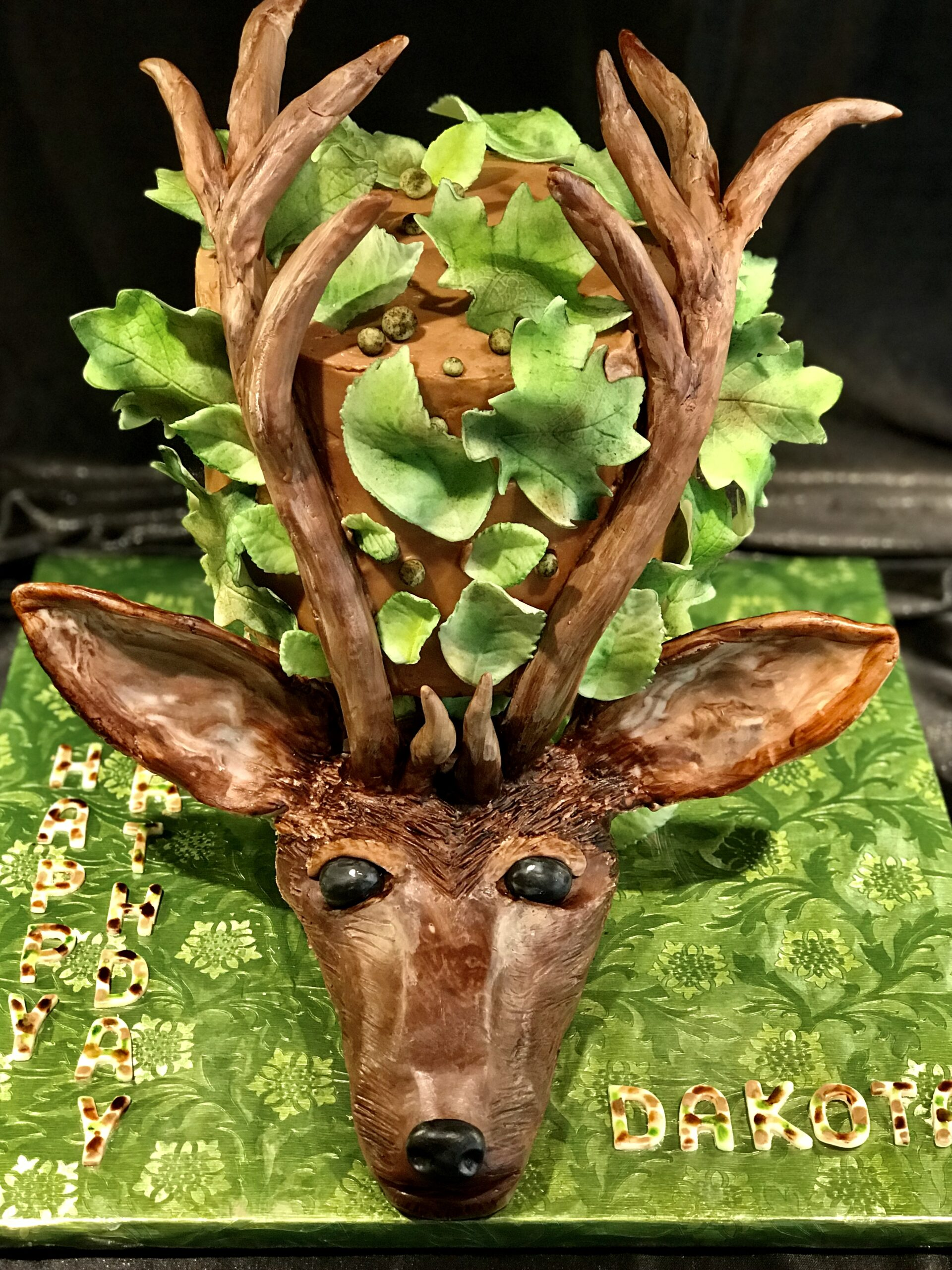 Boy's birthday cake with a 3-D elk's head made out of chocolate